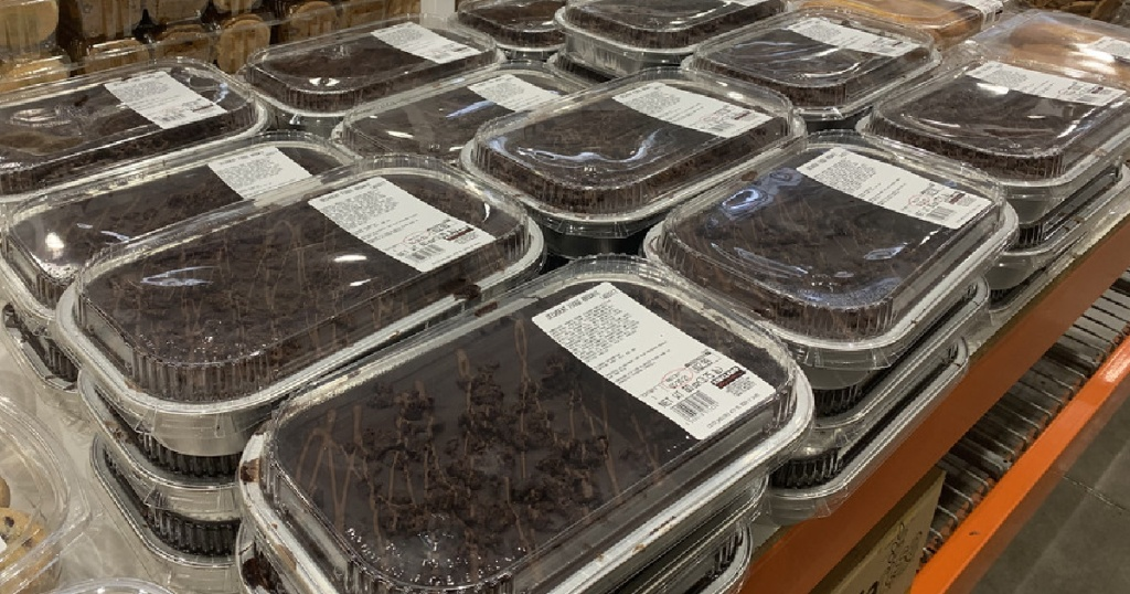 large fudge brownie containers on display table in store