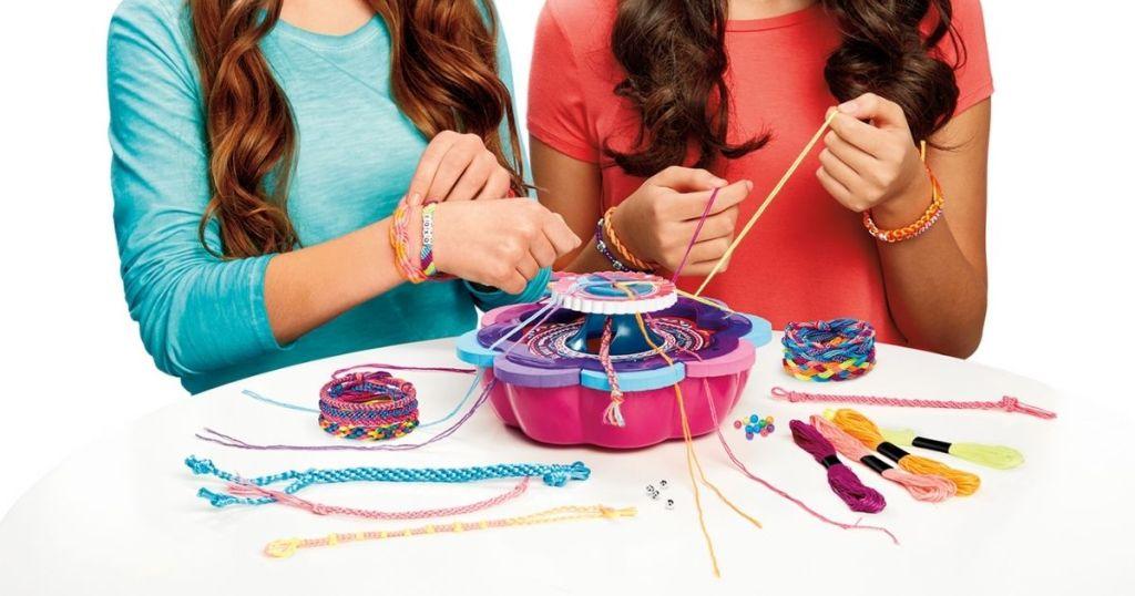 2 girls using Cra-Z-Art Friendship Bracelet Kit