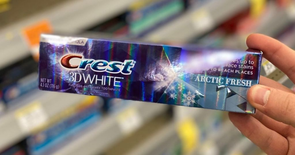Crest Toothpaste in man's hand