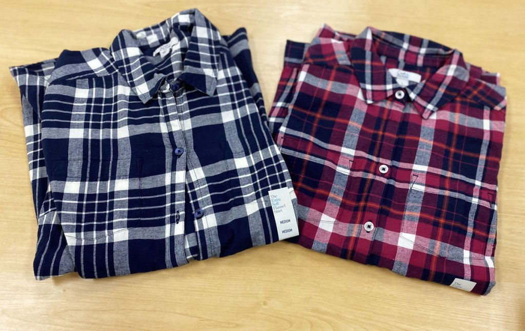 two croft & barrow flannel shirts folded next to each other on wood display