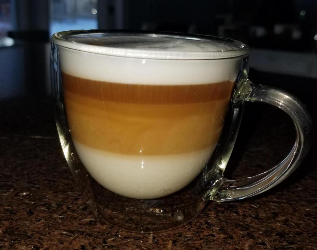 Cup of espresso with milk