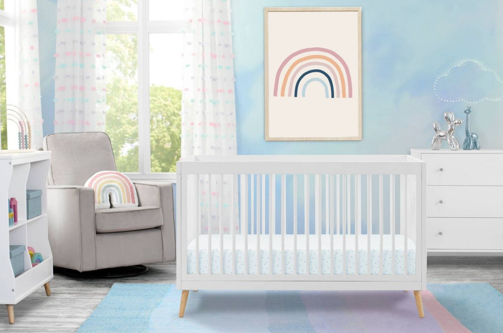baby nursery with rocking chair, crib and dresser
