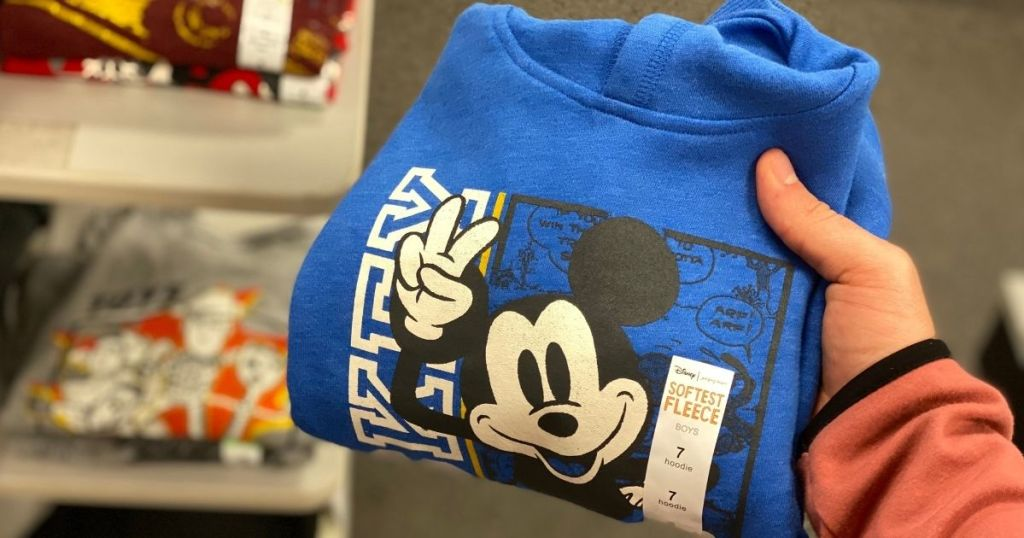 hand holding Disney Jumping Beans Mickey Mouse Hoodie in store