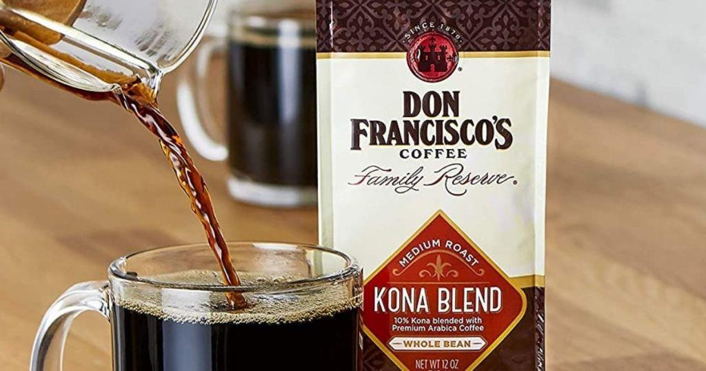Don Francisco's Kona Blend coffee bag next to mug