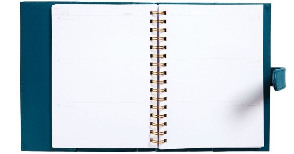 Dwell Studio Teal 12-Month Undated Planner laying open