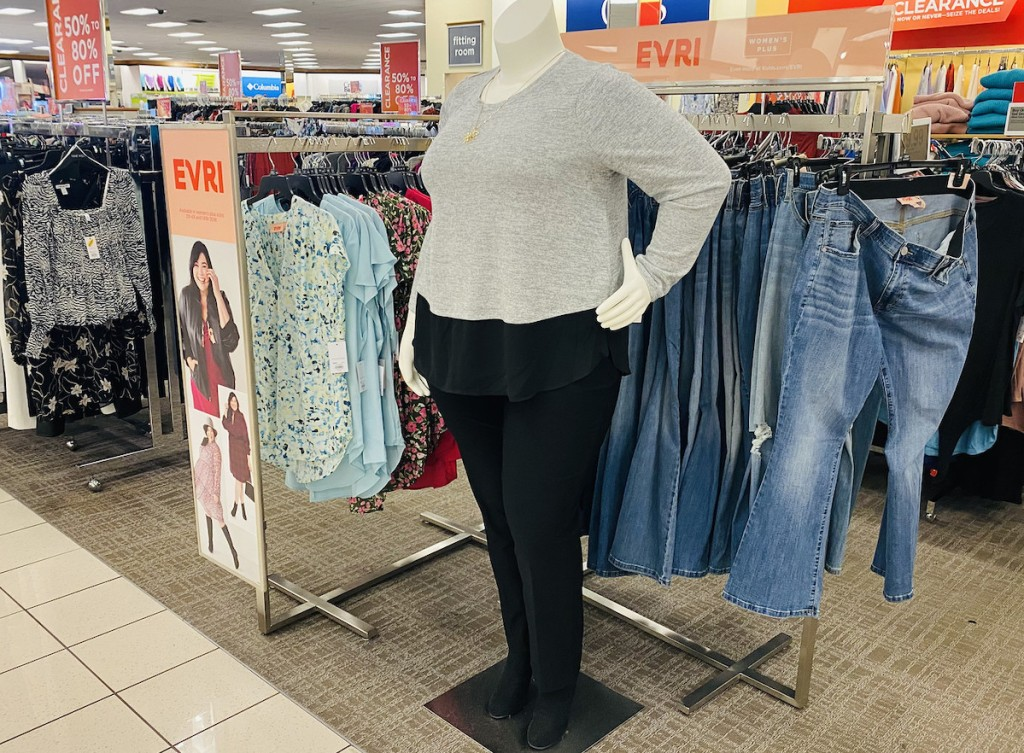 mannequin with black and gray clothing in store