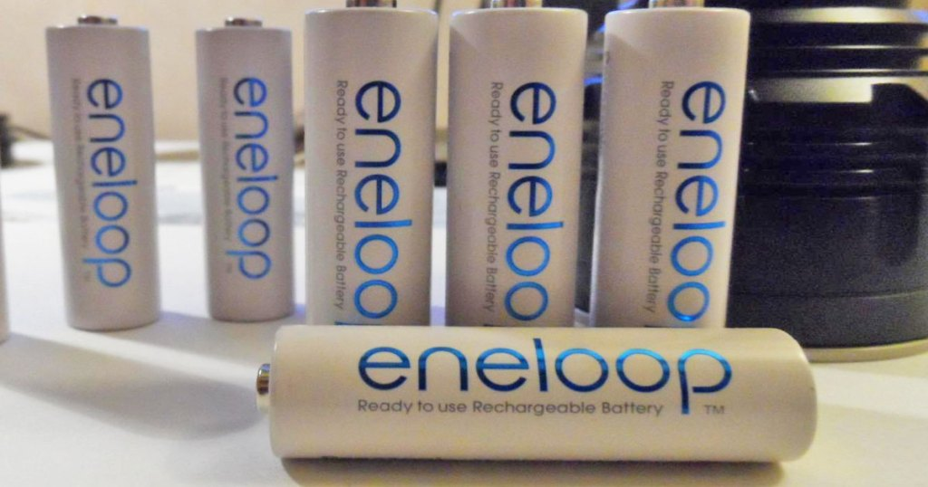 white and blue eneloop batteries on a desk