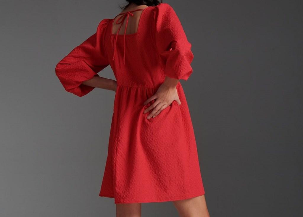 woman wearing a red dress