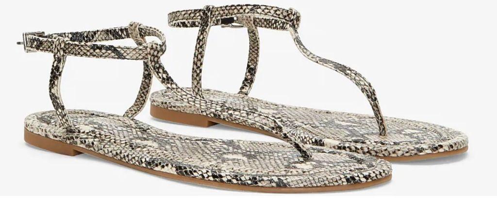pair of Express Snakeskin Thongs
