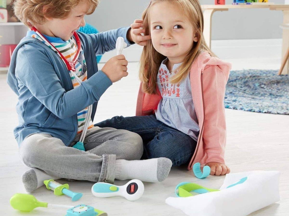 Kids Playing with Fisher Price Medical Kit