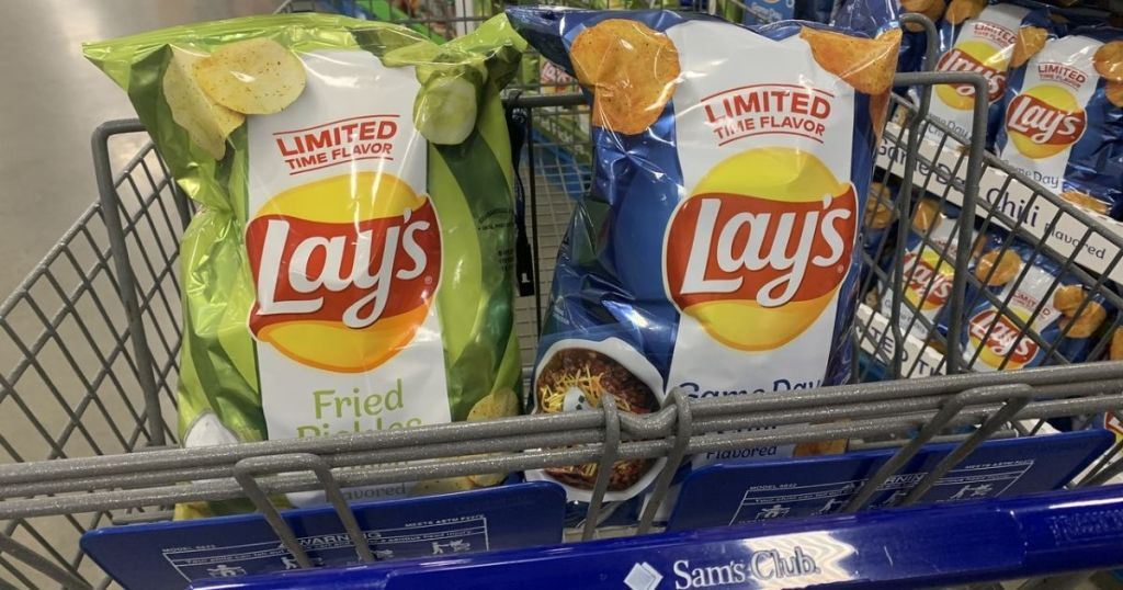 Two bags of Lay's potato chips in front basket of shopping cart