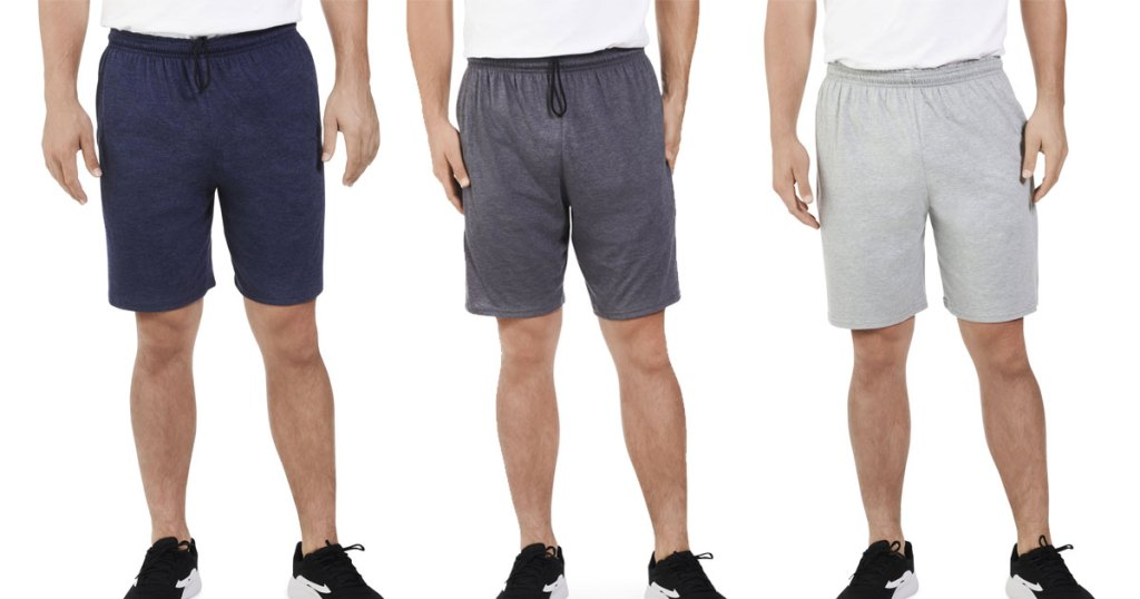 three men modeling jersey shorts in navy blue, dark grey, and light grey colors