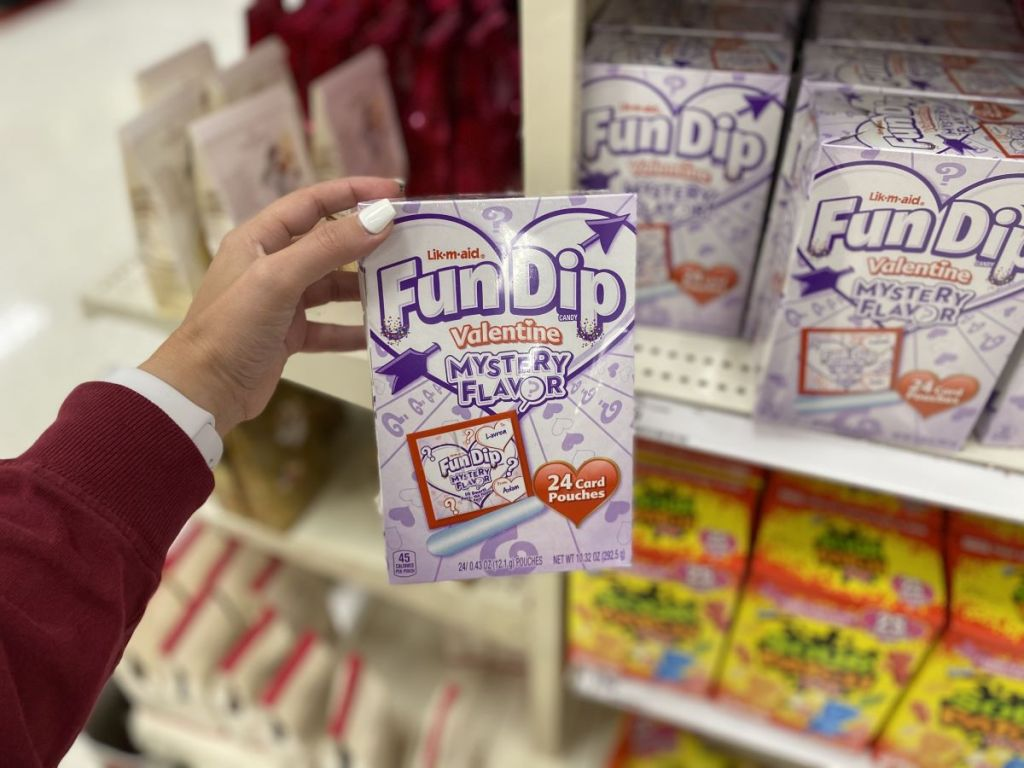 hand holding a box of Fun Dip valentines