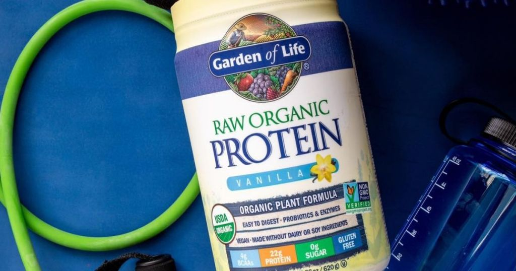 Garden of Life Protein powder container by a water bottle