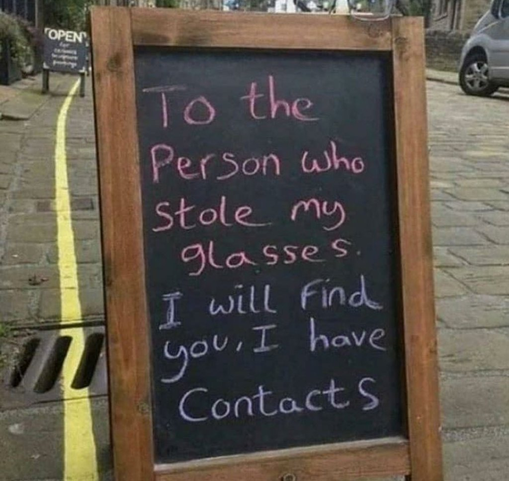 chalkboard sign about stolen pair of glasses