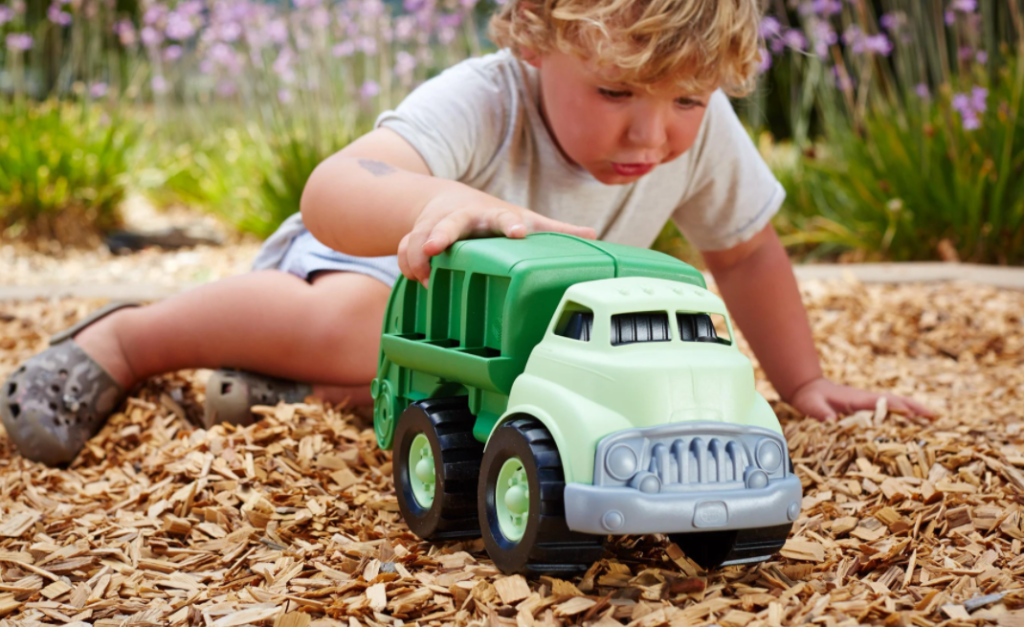 boy playing with a Green Toys Recycling Truck