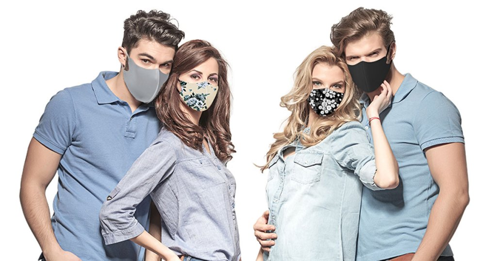 two couples standing near each other wearing reusable face masks