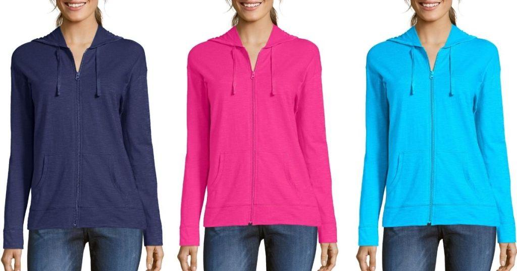 three women wearing full zip hoodies
