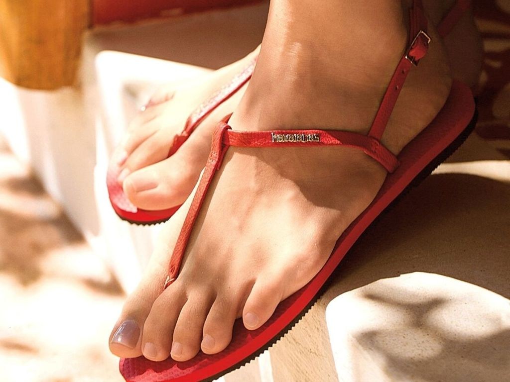 red sandals with Havaianas logo on side