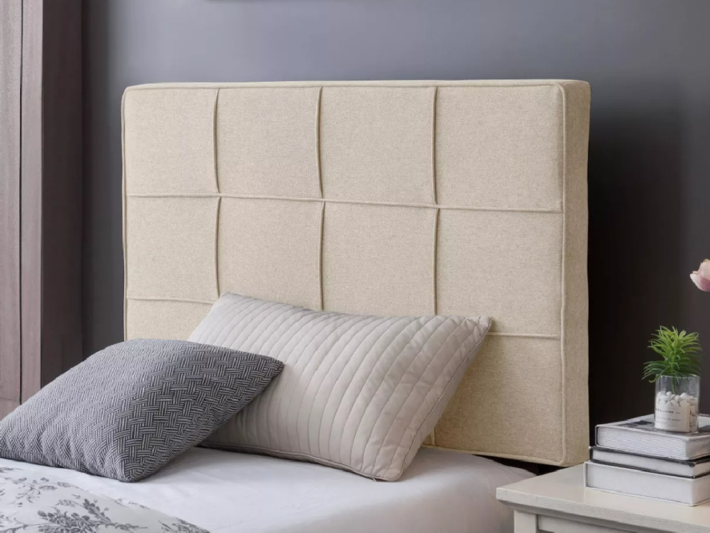 tan colored upholstered twin size headboard