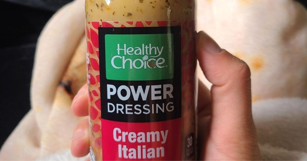 hand holding bottle of Healthy Choice Power Dressing