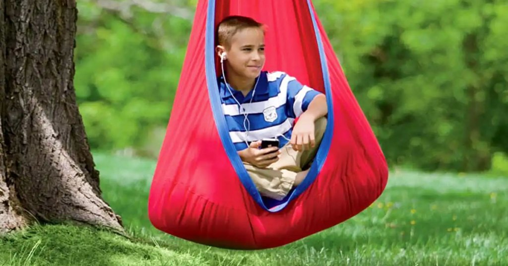 boy in red and blue nylon pod swing