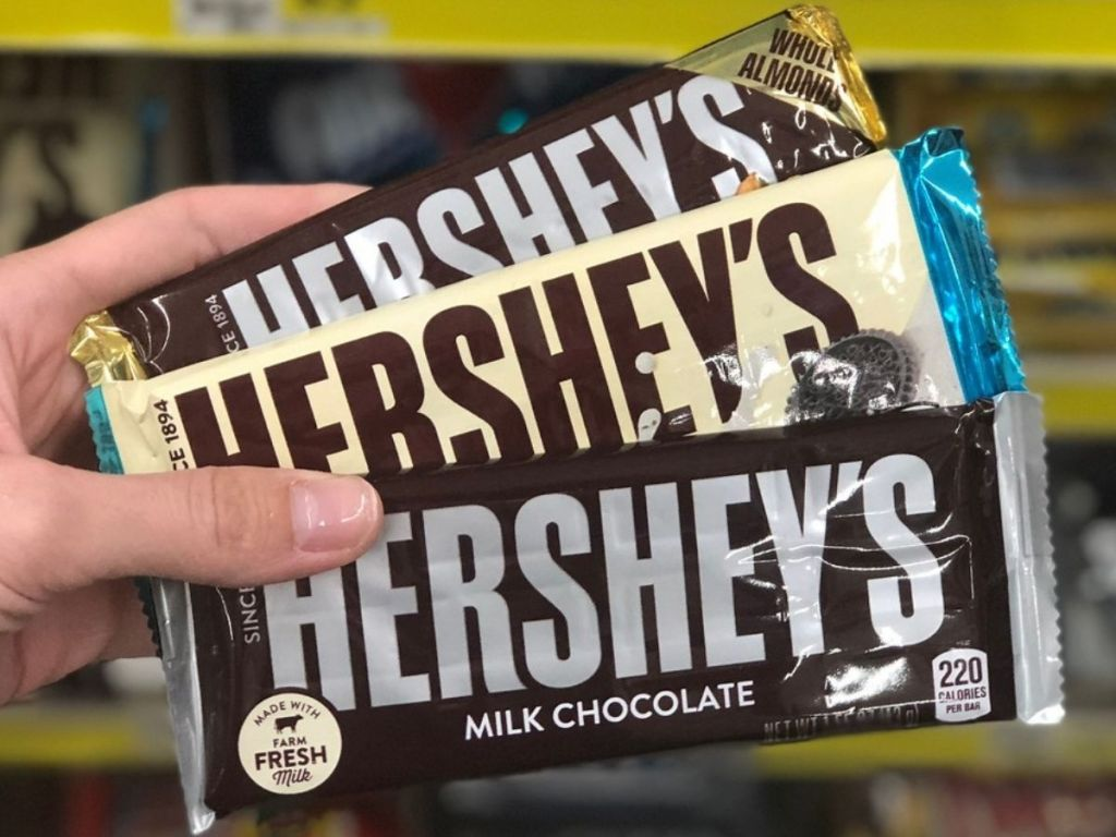 3 Hershey's chocolate bars in woman's hand