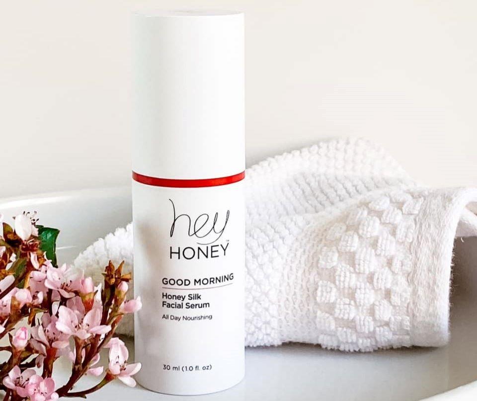Hey Honey Facial Serum next to a towel