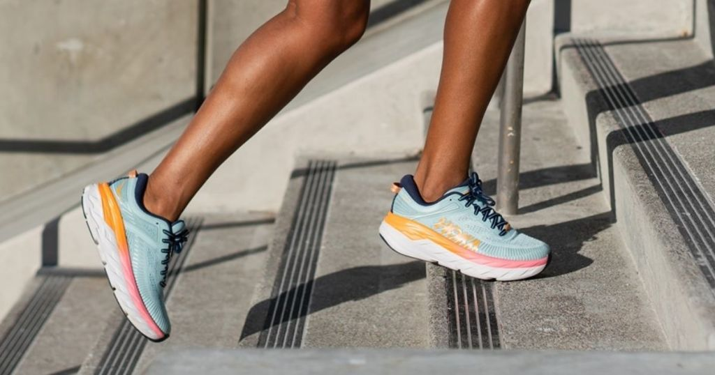 person running up stairs in Hoka One One Arahi 4 Running Shoes