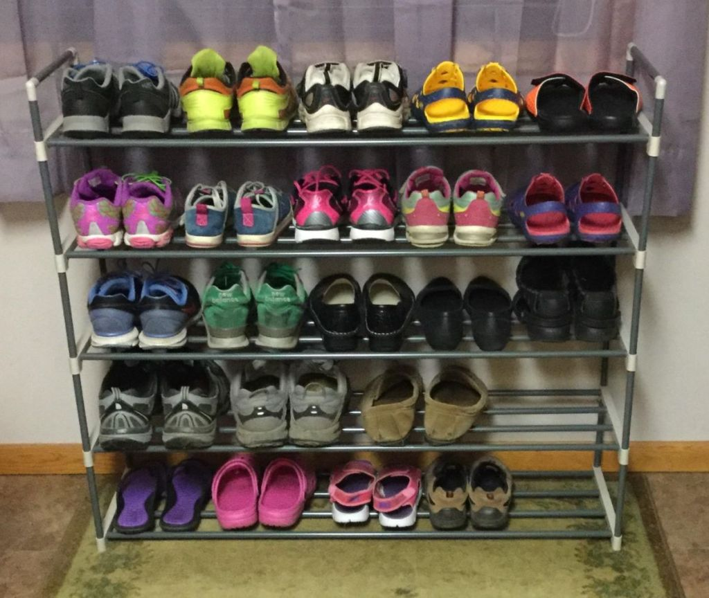 shoe rack with shoes on it