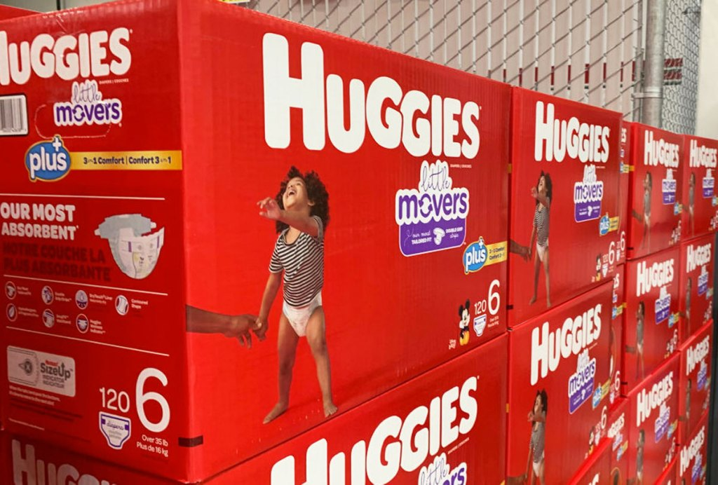 red boxes of huggies little movers diapers stacked on top of one another