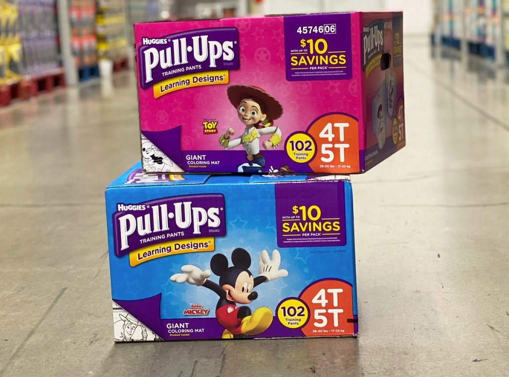 two boxes of huggies pull ups stacked on each other on floor of sam's club