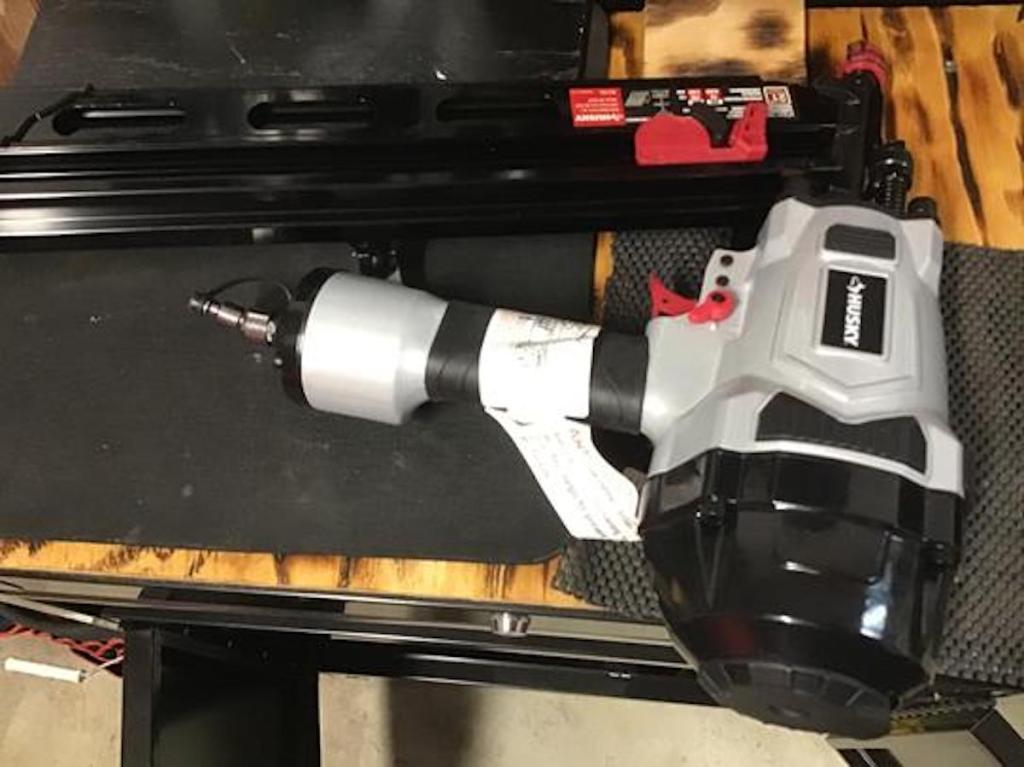 husky nail gun laying on project
