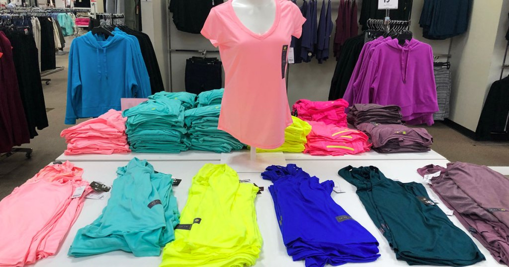 display of women's xersion activewear tops at jcpenney
