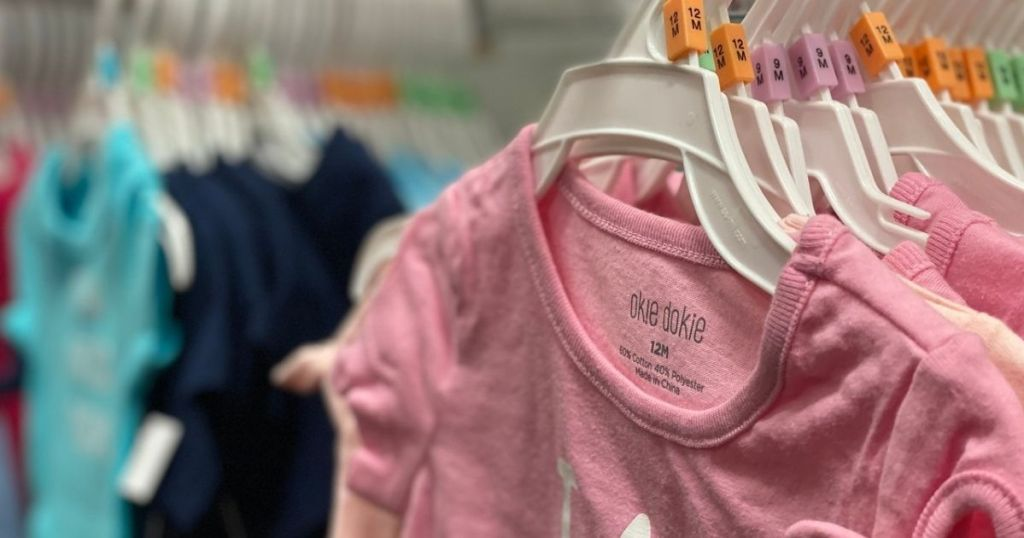 JCPenney Okie Dokie Baby Outfits hanging in store