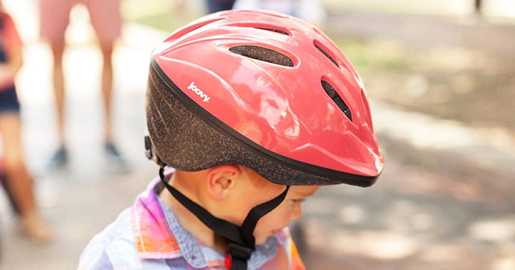 boy with a red and black helmet on his head