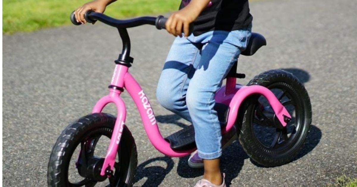 girl riding KaZAM Bike in pink