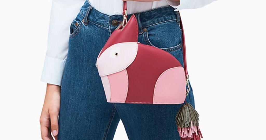 lady in jeans w/ Kate Spade Nadia Fox Crossbody