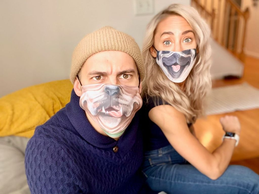 man and woman sitting together and wearing face masks