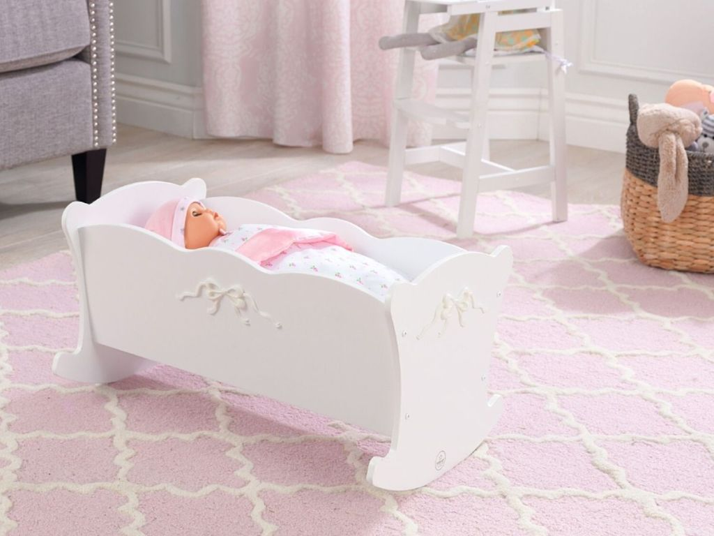 baby doll in white doll crib