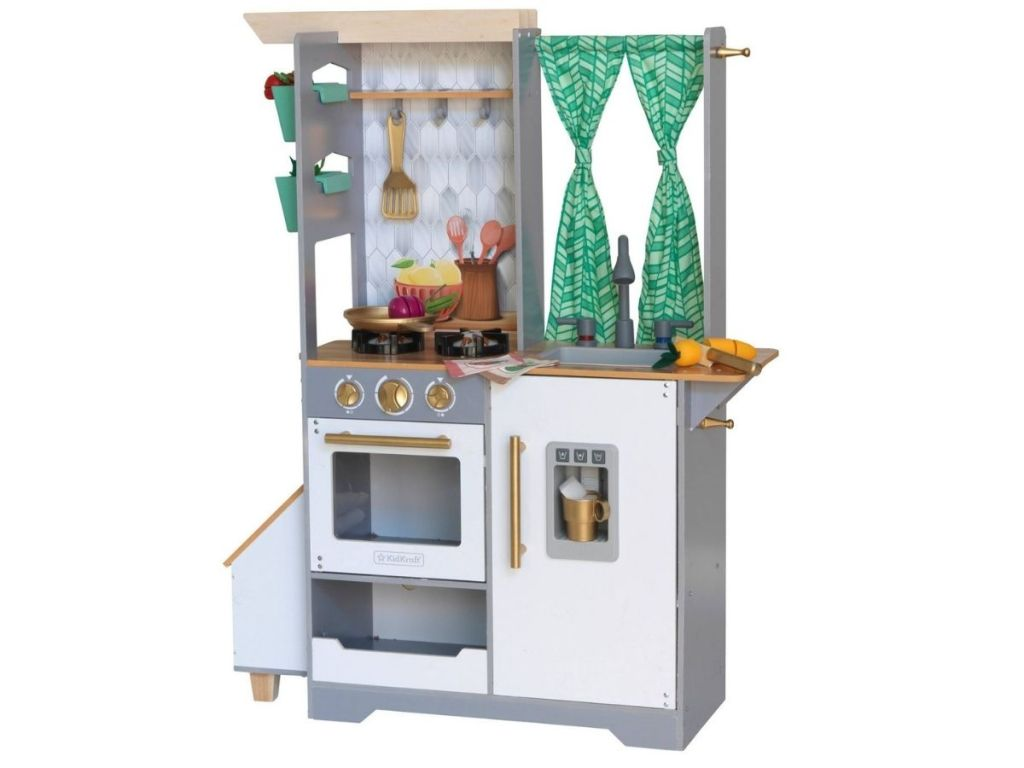 play kitchen with a stove and curtains