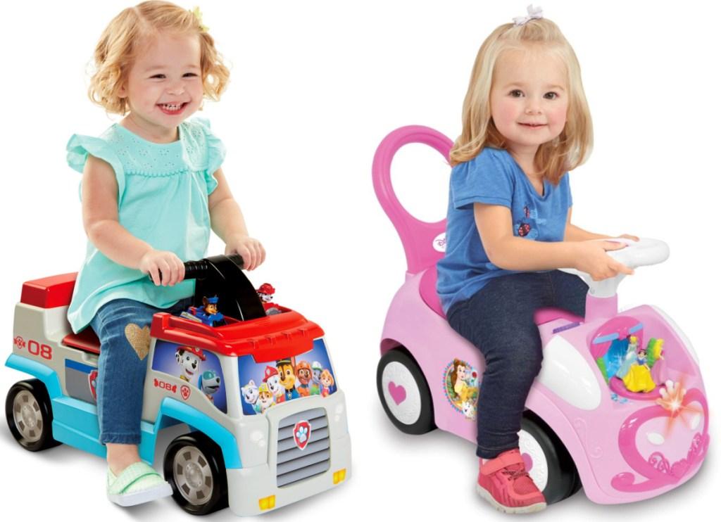 2 little girls sitting on ride on toys