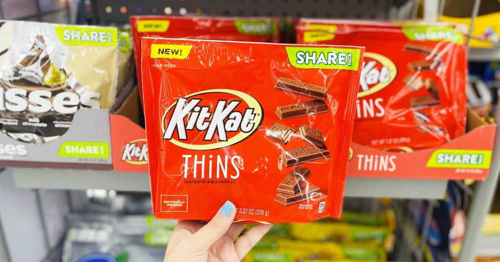 hand holding package of Kit Kat thins