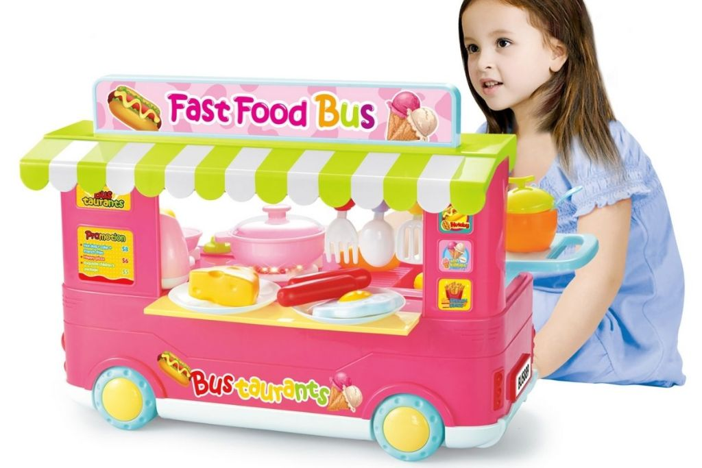 girl playing with Kitchen Connection Fast Food Bus