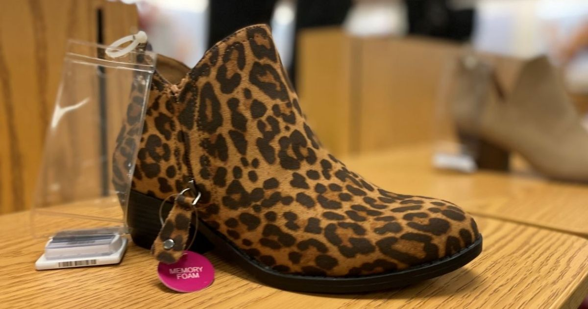 women's animal print bootie on display in a store