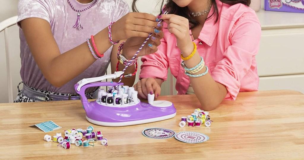 Girls creating with KumiKreator Bracelet Maker