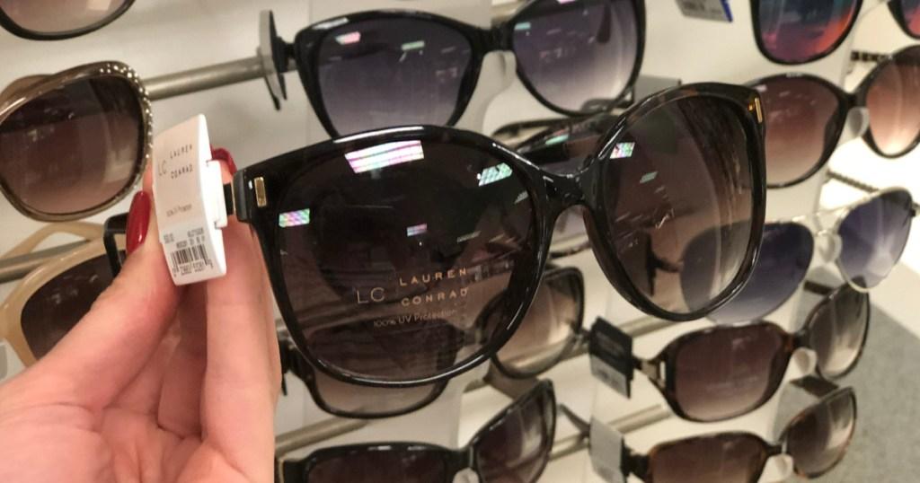 woman's hand holding LC Lauren Conrad Sunglasses at kohl's