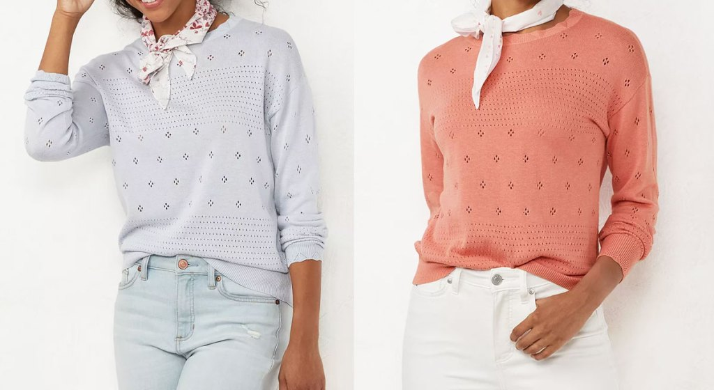 two women modeling crew neck sweaters in light blue and salmon pink colors