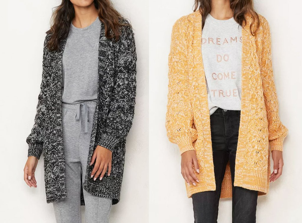 two women modeling long knit cardigan sweaters in black and yellow colors