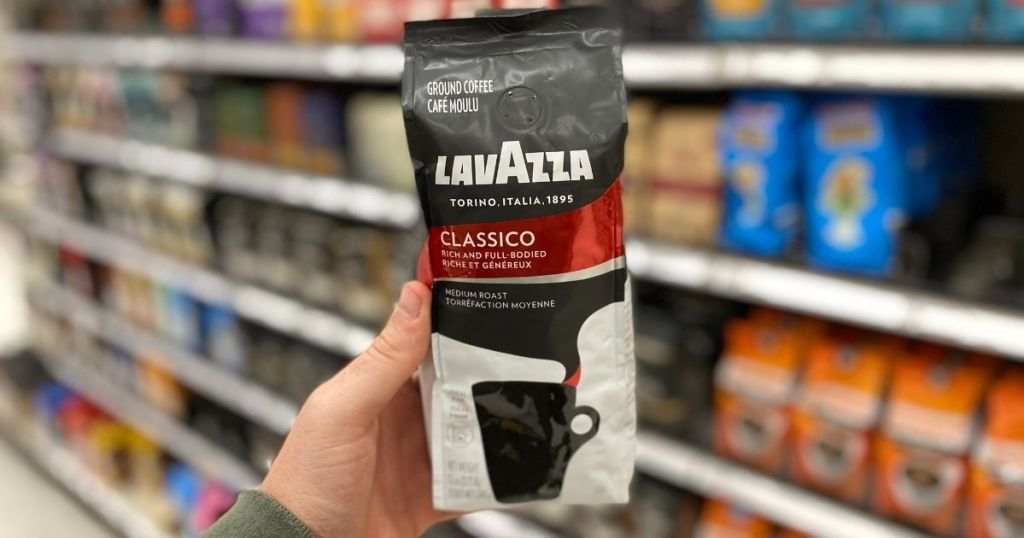 hand holding LavAzza Coffee